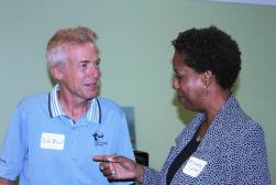 Two members of the West Side Business Network talk while at a West Side Bridge networking meeting.