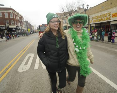 Village clerk Vanessa Moritz of Forest Park and Tami Zippmann of Clarendon Hills marching in the Forest Park St. Patrick's Day parade. (Jennifer Wolfe/contributor)