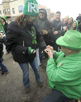 Jennifer Christoffel, left, and Mike Iniquez, of Cicero, became engaged when she saw a float go by asking for her hand in marriage. (Jennifer Wolfe/contributor)