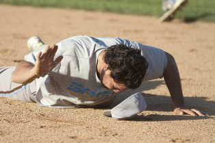 Sage's Art Blake smacks the dirt after making a diving play and just missing getting the runner out at first. (David Pierini/staff photographer)
