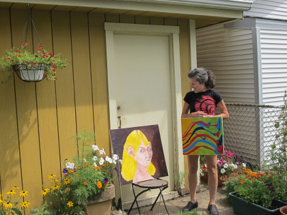 Painter Amy Turilli will transform garages in the 1000 block of Marengo into an art gallery walk on Saturday, Aug. 23. (JEAN LOTUS/Staff)