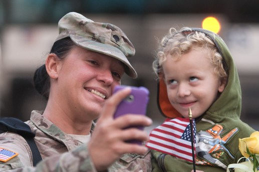 Bentley Holmes, 3, was happy to see his aunt, Spec. Ashley Williams, but gave a goofy face for the return-home selfie. (David Pierini/staff photographer)