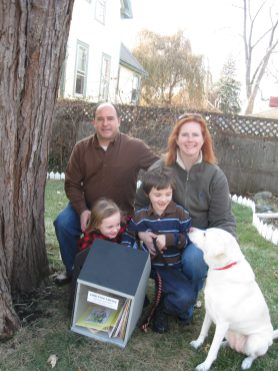 The Bells with their wee library branch: John and Kat, Fiona, Locklin and Lily the dog.