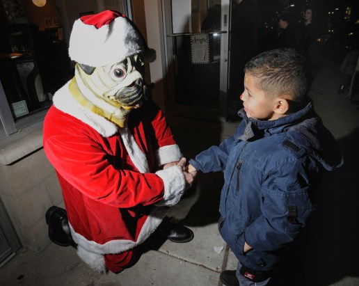 Santa Paws, outside DeeDee and Edee, with Leonidas Campbell, 5 of Forest Park, during the Holiday Walk. (Jennifer Wolfe/Contributor)