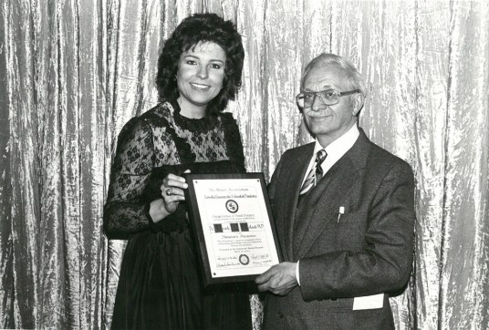 Judy Baar Topinka presents an award to Dr. Frank Orland, Forest Park dentist and founder of the Historical Society in Aug., 1983. Courtesy: Laurie Kokenes