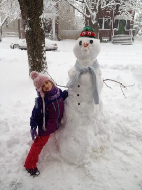 Here's Lily Wood with her amazing snowman. Send your best photos to jean@forestparkreview.com and we'll post them in a snowman parade.