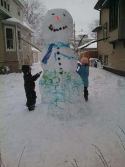 Storey and Nolan Novak put final touches on their 7ft 6in snow buddy.