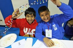 Sakthi Kumar (left) and Aldo Carrizalez (Right) show off the DNA double helixes they built at Field-Stevenson Science Night Feb. 6. (Photo by Keegan Brown)