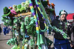 A vendor carted festive tchotchkes down the street. (CHANDLER WEST/Staff Photographer)
