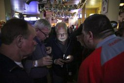SupportersForest Park Mayor Tony Calderone, and his slate, check their cell phones for election results, at Healy's Westside on Tuesday, April 7, 2015. | CHANDLER WEST/Staff Photographer