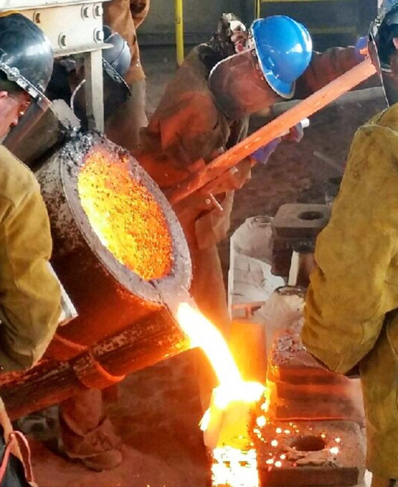 Working with molten metal requires plenty of teamwork. | Courtesy Sarah Harling