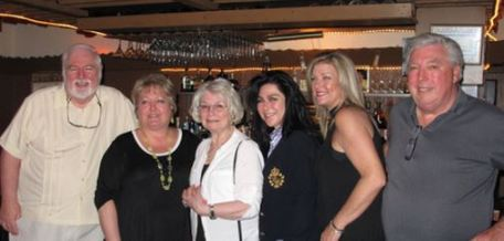 (From left to right) Chuck Sullivan, Kelly Lifka, Patricia Hopkins, Maggie DeNardo, Colleen Cipriana and Orville Kron at Golden Steer on May 2, formerly a pub run by members of his family.   Courtesy Chuck Sullivan