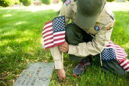 Cyrus Murray, 14, plants a flag. | William Camargo/Staff Photographer