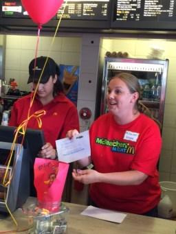 Mrs. Novak working the counter at McTeacher's Night.