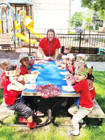 Teacher Jane Catezone and her Garfield students enjoy an outing in the park at Adams and Thomas. | Courtesy Jane Catezone