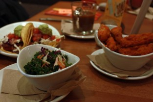 Native Foods Super Slaw (front), Baja Blackened Tacos (background), Buffalo Chicken Wings (right) - photo by Ashley Lisenby