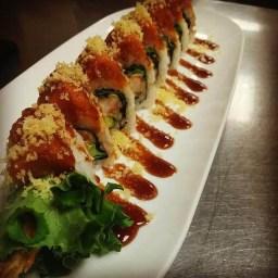 Our new Mt. Fuji maki of cream cheese and shrimp tempura topped with tempura crumbs, spicy tuna and unagi sauce giving a very savory taste.