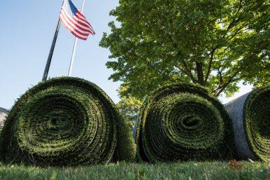 Rolls of artificial turf awaiting installation. | William Camargo/Staff Photographer
