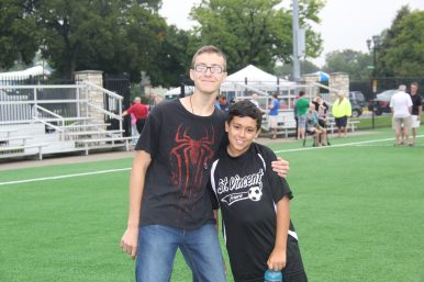 Jaxon Entler and Miles Smith pose for a picture on the newly installed field. | Courtesy Rachell Entler