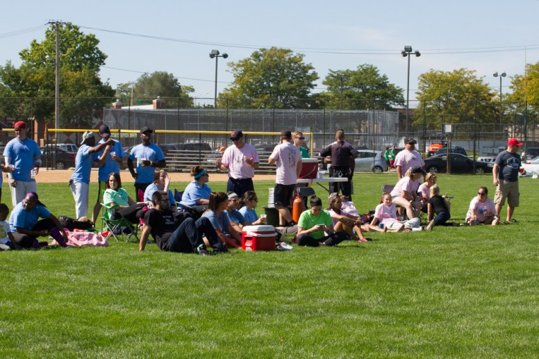 People gather in Forest Park to watch a Softball tournament to fund raise for Opportunity Knocks. | William Camargo/Staff Photographer