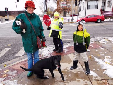 Brianna, Josh and Tucker the dog with crossing guard Karen Stuart. | JACKIE SCHULZ/Contributor