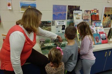 Photo Credit: Grace Finn Art teacher Ms. Skelton shows students a beautiful pop-up book.