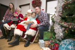 Santa Claus and Mrs. Claus pose with Clara and Brian Houdek, their two girls, Bianca, 3, and Natalie, 7 months, at the Park District of Forest Park's Breakfast with Santa Claus.   Rick Majewski/Contributor