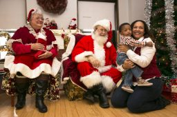 Ellis Murray, age 2, of Forest Park, with his mother Eboni Murray, pose for a photograph with Mr. and Mrs. Claus at the Park District of Forest Park's Breakfast with Santa last Saturday.   Rick Majewski/Contributor