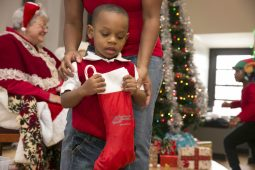 Tyler Welch, age 3, holds his stocking filled with Christmas goodies.   Rick Majewski/Contributor