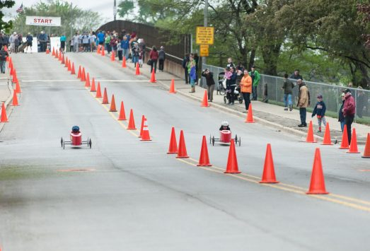 Fans cheer on participants at the Soapbox Derby Tournament on the Circle Avenue bridge in Forest Park. | File photo