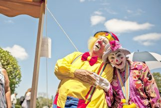 Kiwi the clown and a friend at the 16th Annual Clown Festival, which commemorated the train wreck of June 22, 1918 that killed many circus performers and animals from the Hagenback-Wallace Circus. The annual festival was held at Showmen's Rest in Woodlawn Cemetery in August. | File photo