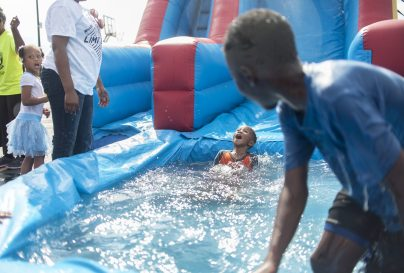 Jeremiah Banks enjoys the water slide during the Back 2 School Celebration, Concert and Supply Giveaway that took place on Aug. 7 at Living World Christian Center. | File photo