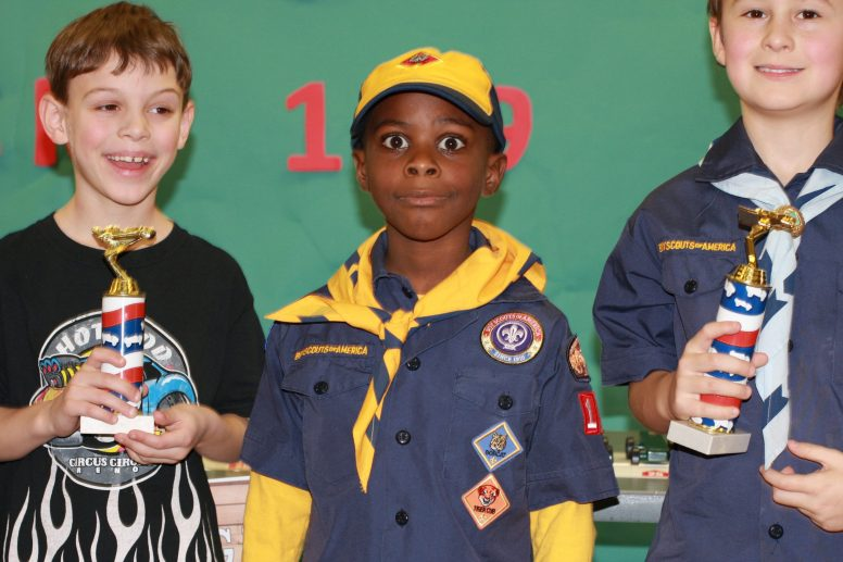 (Left to right) Tucker Hill (2nd), Carter Leonard (3rd) and Brandon Arnold (1st) led the pack in the Pinewood Derby last weekend. | Photo by Keegan Brown