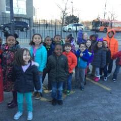 Kindergarten students waiting to get inside United Center.