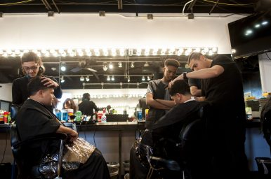 Octavio G?lvez and Ricardo Villanueva work on their classmates hair while Justin Simmons watches over on February 4, 2016 at the Erskine Reeves Barber Academy. | William Camargo/Staff Photographer