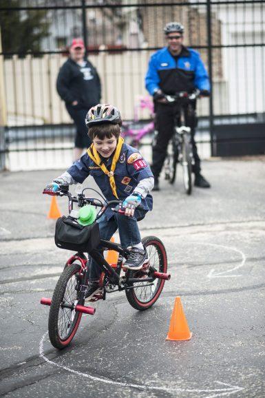 Locklin Bell, 7, rides through the bike course. | William Camargo/Staff Photographer