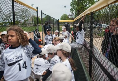 The Forest Park White Lightning get ready for their opening day game against the Elmwood Park Expos on Saturday, May 7.   William Camargo/Staff Photographer