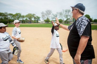 White Lightning receive high fives after getting three outs.   William Camargo/Staff Photographer