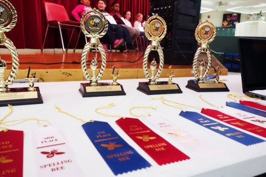 First, second and third place awards lined up and ready to hand out to winners of the annual District 91 spelling bee. | Photo by Grace Finn