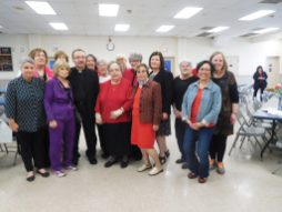 Father Stan Kuca with the committee who organized his 25th anniversary event. | JACKIE SCHULZ/Contributor