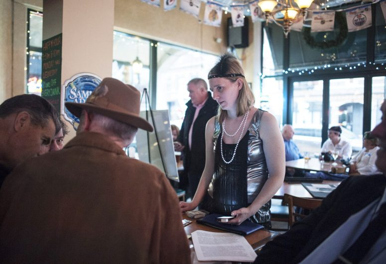Diane Grah, executive director of the Historical Society of Forest Park, registers people at the beginning of the 2nd annual Prohibition Tour, which took place on May 13 in several Forest Park bars. | William Camargo/Staff Photographer