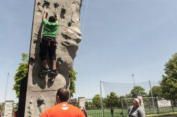 Javon Henderson climbs a rock wall. | William Camargo/Staff Photographer
