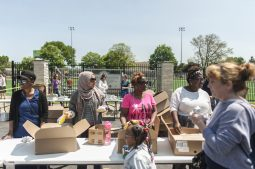 Parents and volunteers help hand out lunch. | William Camargo/Staff Photographer