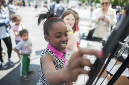 Kayla Gray spins the wheel and wins a prize after answering questions about financial responsibility. | William Camargo/Staff Photographer