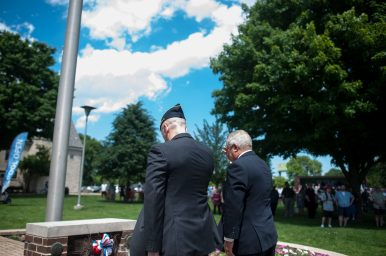 Forest Park Mayor Anthony Calderone and Sergeant Knute Weicks salute the memorial landmark in Forest Park. | William Camargo/Staff Photographer