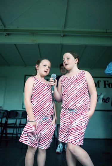 Maggie and Ginny Redmond sign the national anthem. | William Camargo/Staff Photographer