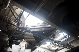 The roof of a commercial building near Living Word Church on Roosevelt Road suffered significant damage during a strong storm that blew through Forest Park on May 31. (Photo by William Camargo)