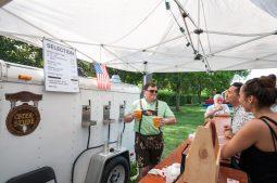 Christopher Duncan serves German beer. | MAX HERMAN/Contributor