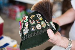 Volunteer Alfred Mueller shows off various pins he has collected from Germany. | MAX HERMAN/Contributor