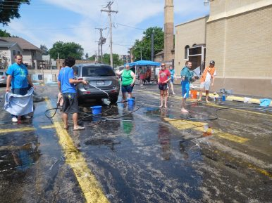 St. John teens raise funds with a car wash. | JACKIE SCHULZ/Contributor